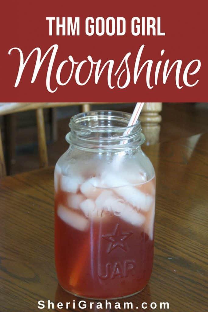 Good Girl Moonshine in a quart jar on the table